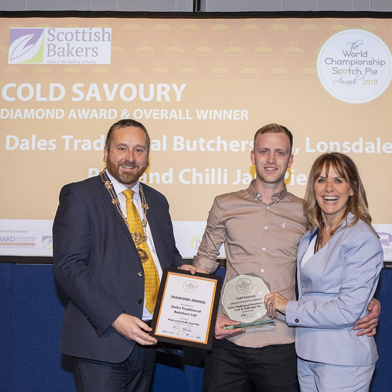 Ira Collier of Dales Butchers collecting their diamond award for best cold savoury at The World Championship Scotch Pie Awards 2019